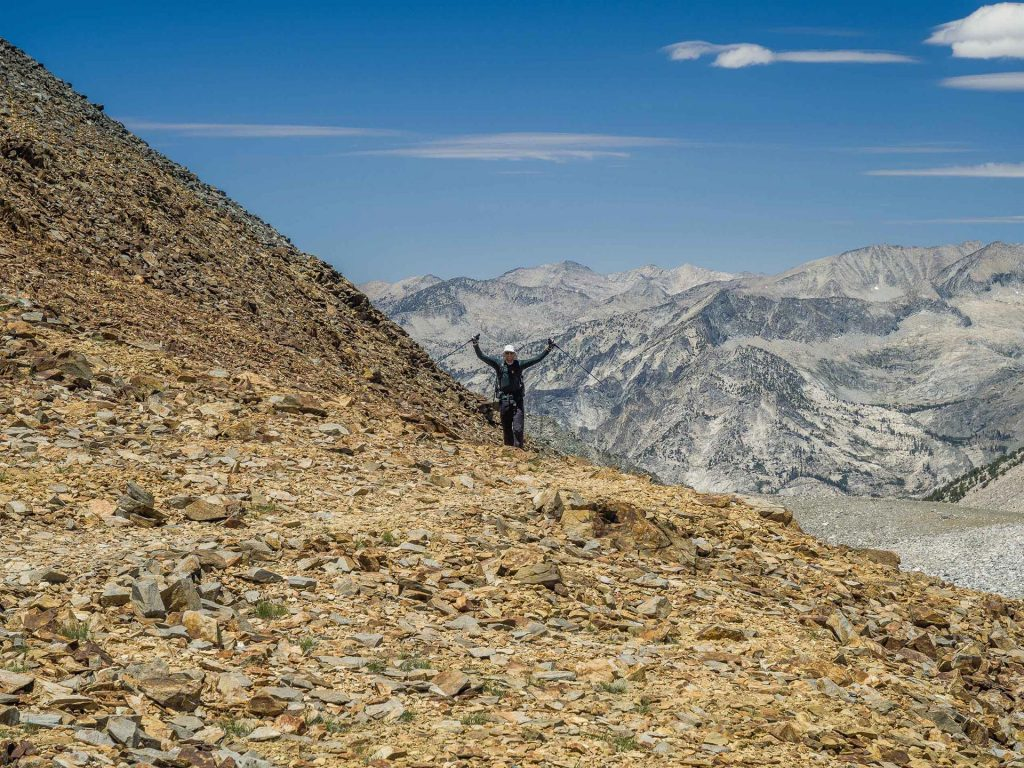 Ben puts his arms up when he gets to the top of Baxter Pass