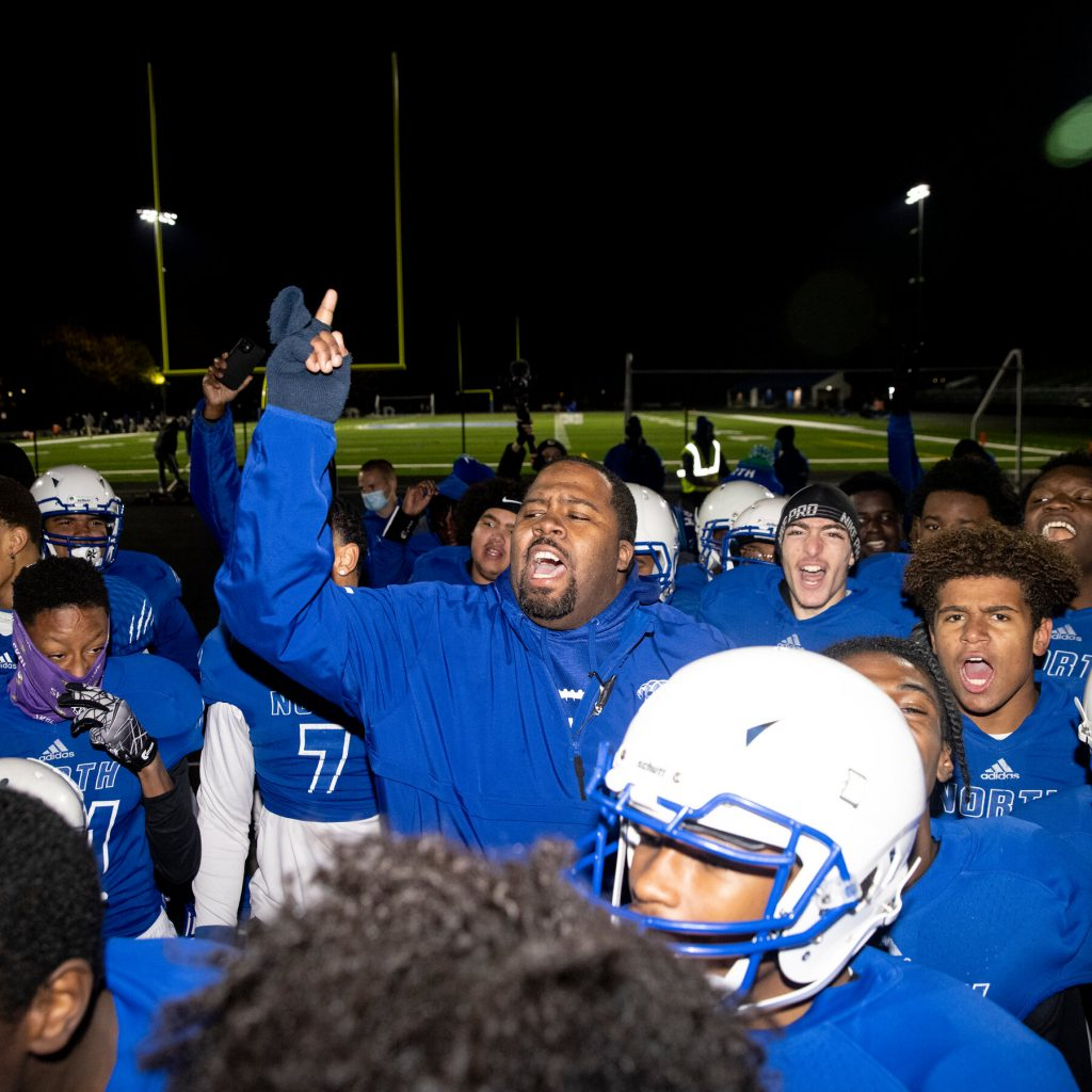 Coach George Adams celebrates with his team