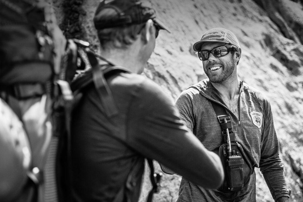 Climber shakes a ranger's hand on Mt. Rainier