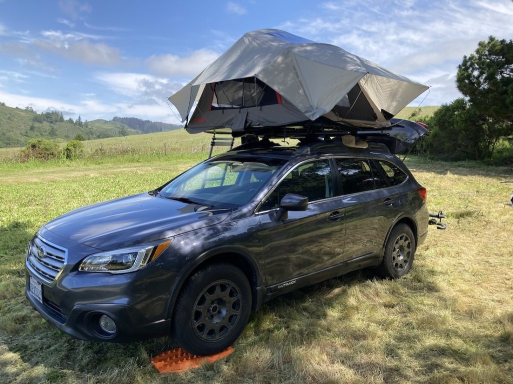 Subaru Outback with a rooftop tent